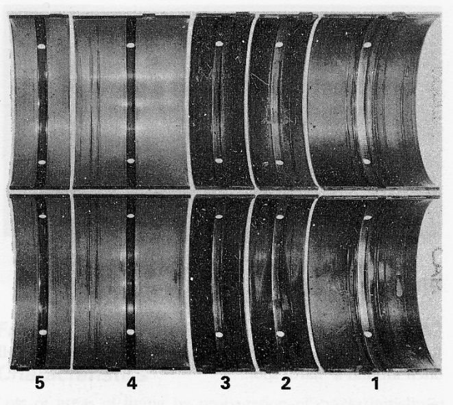 Several bearings showing the typical hallmarks of cavitation corrosion