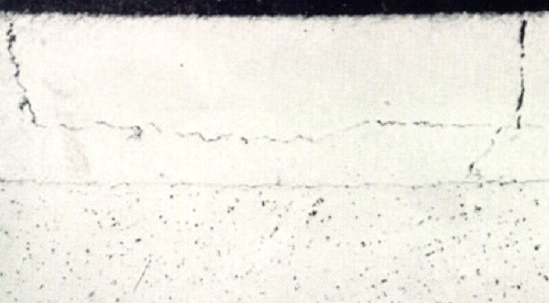Image shows fatigue cracks in a journal bearing