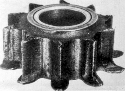 severe erosion of gear teeth from long term exposure in contaminated oil